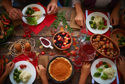 High angle view of Thanksgiving table with people eating